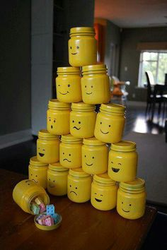 """Lego party goody """"bags"""" I just spray painted baby food jars and their lids with Sunshine Yellow. Then I used a Sharpie and drew on the Lego men faces. I filled them with Lego candy found in the bulk section of my grocery store. Lego Party Favors, Party Gifts, Party Bags, Party Party, Birthday Fun, Birthday Parties, Birthday Ideas, Lego Parties, Lego Friends Party"""