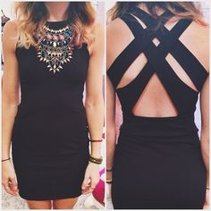 Criss cross black dress+statement