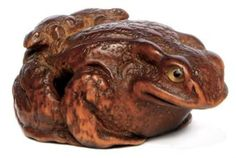A Wood Netsuke   Signed Kokei, Edo Period (19th century)   Of a toad with two young on its back, inlaid eyes