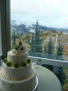 Green flowers on white cakes.  Look so lovely.