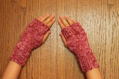These cute and trendy hand knit fingerless gloves keep your hands warm while allowing your fingers the freedom to do what they need. Great