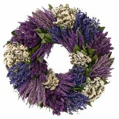 """Adorned with white sinuata and lavender, this lifelike wreath is a welcoming accent whether in the entryway or displayed above your mantel.   Product: Preserved wreathConstruction Material: Silicone Color: Lavender and whiteFeatures:  Includes grass, sinuata, phalaris and natural leaves  Handmade  Dimensions: 22"""" Diameter x 4.5"""" DCleaning and Care: Avoid sunlight, moisture,  heat and humidity. Wipe clean with a dry cloth"""
