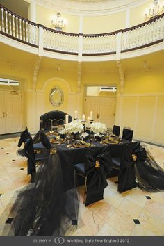 Midnight black linen with contrasting gold accents showcasing white Casablanca lilies. @grace_ormonde @wedding_style