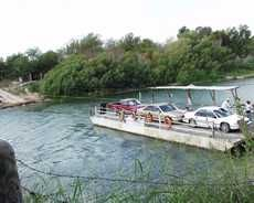 The Los Ebanos Ferry. Just a stone's throw from McAllen, it is the last hand-operated ferry on the Rio Grande. Most fun you'll ever have getting to Ciudad Diaz Ordaz, MX. Get out of your car and help pull the cable. it's part of the adventure! Rio Grande City, Rio Grande Valley, Mcallen Texas, Texas Travel, Home And Away, Oh The Places You'll Go, Getting Out, Social Studies, Beautiful Things