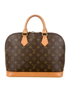 Louis Vuitton Brown and tan monogram coated canvas Alma MM bag with brass hardware, tan vachetta leather trim, dual rolled top handle, brown canvas lining, dual pockets at interior walls and zip closu
