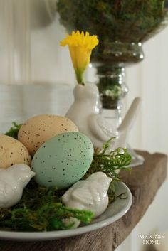 spring mantle decorating with daffodils, moss, birds and eggs