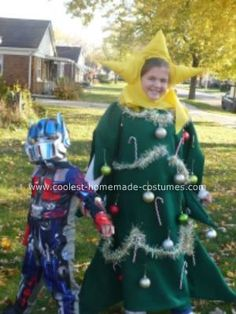 Ruby keeps saying she wants to be a Christmas tree for Halloween.  Raddest kid ever.  Homemade Christmas Tree Costume