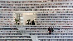 Amazing library in Tianjin, China ... the Binhai Library white & the books provide the color