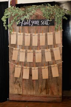 rustic wedding reception escort card/place card idea; photo: B. Schwartz Photography