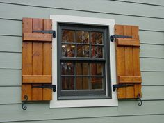 We love these Board and Batten exterior shutters! www.palmettowindowfashions.com