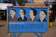 One of many hand-painted roadsigns for hair salons found throughout Senegal.
