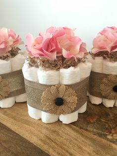 3 MINI SHABBY CHIC DIAPER CAKES with PINK FLOWER TOPPER  . . . To choose your own color or style of flower topper (peony blossoms or hydrangea blossoms), just message me your shower colors and I will find you lovely flower toppers for your minis!  . . . You will receive a set of 3 Mini floral burlap theme diaper cakes. 10 diapers per cake. The silk floral accents can be gender neutral. They will be the perfect centerpieces for you event.  . . . At checkout, I will ask for your shower date so…