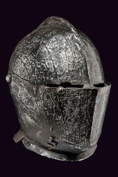 A closed helmet dating: third quarter of the 16th Century provenance: Italy One-piece skull with short comb; wide visor with seat for the co...
