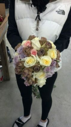 DIY bridal bouquet.  The Amnesia Roses look awesome with the cream and purple ones.u