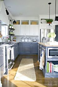 Small Kitchen Makeover 10 Ways to Decorate Above Your Kitchen Cabinets - The area above the kitchen cabinets doesn't have to be wasted; try one of these 10 inventive ways to fill the space from display to storage. Two Tone Kitchen Cabinets, Above Kitchen Cabinets, Custom Kitchen Cabinets, Kitchen Redo, New Kitchen, Kitchen Ideas, Rv Cabinets, Kitchen Island, Kitchen Shelves