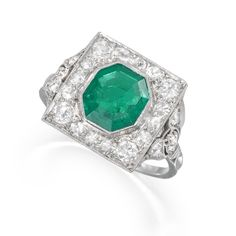 Art Deco emerald and diamond square panel ring, the octagonal-shaped emerald weighing approx. in a brilliant-cut diamond border with pierced shoulders to the ribbed hoop. Art Deco Jewelry, Vintage Jewelry, Flapper Style, Flapper Fashion, Aqua Marine, Emerald Green, Druzy Ring, Vintage Inspired, Heart Ring