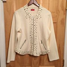 "Ladies cream color studded jacket -XL FIRMIANA ladies cream colored jacket with various size silver studs.  Silver studs on front (outlining zipper closure), front waist, front & back collar.  Two zipper pockets on front.  Jacket has a fitted style.  Listed as XL but runs a size smaller.  Fits more like a large. Made of 41% cotton 41% acrylic & 18% nylon. Very cool all seasons jacket.  New without tags.  Never been worn. Small slits on either side of jacket. Jacket is 24"" long from top of…"