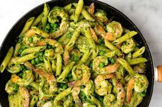 Spinach Pesto Penne with Shrimp and Peas:  Pesto nuts will love this fresh spring combo of spinach, basil, and sweet peas. Plus the shrimp gives you something a little more exciting than the usual chicken. - Delish.com