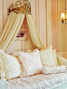 Shabby Chic Girl's Room Daybed    RMS user ajerde chose a daybed for her little girl's room to grow with her daughter. The bed features a canopy topped with an oversized gold crown for a regal look. A soft-pink color palette softens the space