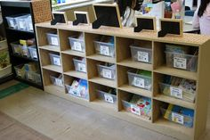 Three ways for young readers to find a book independently - with a picture cue, author or topic, or by bin number in Beth Lawson's second-grade classroom.