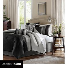 Rejuvenate your bedroom with the fashionable look of this seven-piece comforter set from Madison Park. Featuring a color block stripe design in shades of black and gray, this woven comforter set updat