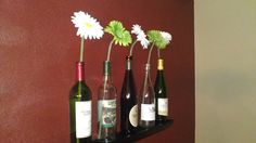 Another Pinterest inspired project. I used a photo ledge shelf that I had and put some different wine bottles on it that have cool labels, with daisies. Simple and different. Looks neat in my dining room. :)