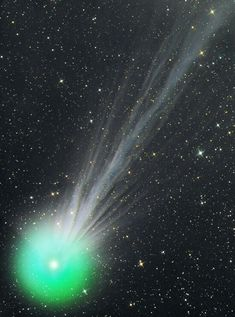 Comet Lovejoy, seen here in January 2015 -- discovered in August 2014, the two, bright, band-like rays in the tail are unprecedented.  This is Australian amateur Terry Lovejoy's fifth comet discovery. And that lovely green color? Comet heads are usually like that; the green glow comes from molecules of diatomic carbon (C2) fluorescing in ultraviolet sunlight in the near-vacuum of space.  <3<3<3<3