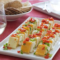 This marinated cheese recipe from Southern Living soaks in delicious flavor as it chills. When assembling, make sure the cream cheese is thoroughly chilled for easier slicing. Finger Food Appetizers, Yummy Appetizers, Appetizers For Party, Finger Foods, Appetizer Recipes, Snack Recipes, Cooking Recipes, Cheese Appetizers, Aperitivos Finger Food
