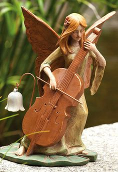 Fairy With Cello Pond Symphony Fairies.  http://www.efairies.com/store/pc/Samantha-The-Suffolk-Fairy-Statue-Ships-Separately-52p4817.htm  $29.95