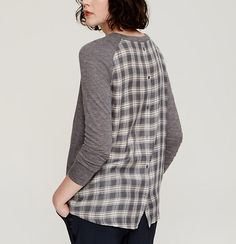 Fluid woven panels meet a soft knit for the ultimate mix up - with a cool plaid buttoned back. Crew neck. Long sleeves. Drop shoulders. Shirttail hem. Knit front and sleeves, woven back.