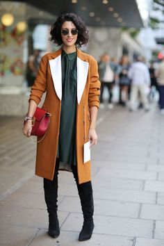 Dark green dress + orange coat + tall boots
