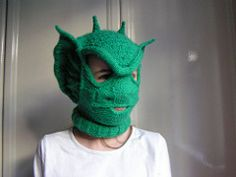 A one-size-fits-most reptilian balaclava. Knit mostly in the round, with a few flat sections and a little bit of attached I-cord edging thrown in for good measure.