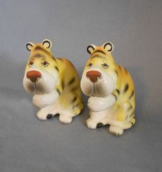 1960s Vintage Sad Tigers Porcelain Salt and Pepper Shakers, Japan . . . Endearing and sweet big eyed yellow-gold tiger shakers. So unique! . $17