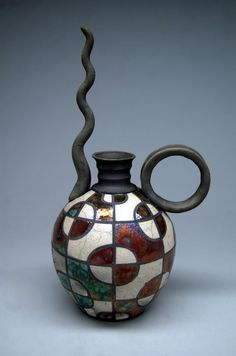This oil can was made on the wheel in the potters studio in Historic Downtown Waukesha. It started as a 1.5lb ball of clay and was completed using his