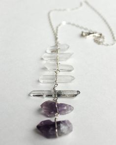 Statement Necklace crystal necklace Rough by ChickpeaDesignStudio, $160.00 ETSY Wire wrapped tibetan crystal points with inclusions and rough cut amethyst points hang in parallel planes in this very unusual necklace. Suspended from a simple 22 inch .925 silver 4mm medium weight oval link chain. Points range from 6mmx27mm to 11x46mm and drop 5.5 inches below the chain.