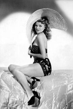 Rita Hayworth, 1940s Here's our next look for Ibiza sorted. Rita Hayworth works a printed bikini, huge sun hat and peep-toe heels. If only w...