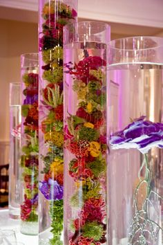 Flora New York recreated coral shapes with flowers submerged in cylindrical vases, and included nautilus shells filled with...