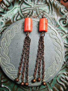 Coral Copper Dangle Earrings gorgeous bohemian by themoonandthesea, $18  long dangle earrings over four inches coral beads paired with vintage copper gorgeous urban mermaid boho jewelry by designer Nuit Moore