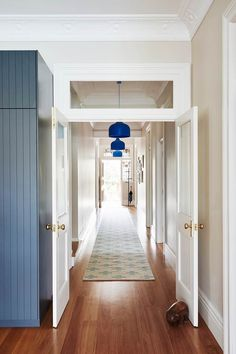 A balance between vibrant and neutral colours and modern and heritage details, gives this Sydney Federation home an elegant and bespoke style. Kitchen Lighting Design, Modern Lighting Design, Hallway Colours, Edwardian House, Hallway Lighting, Entry Hallway, Australian Homes, House Extensions, Home Reno