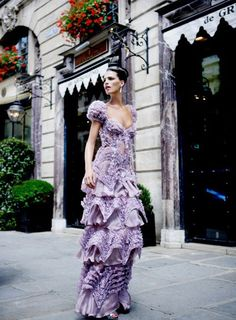 The gown is gorgeous ... but my eye also loves the pretty canopied storefronts! {via ZsaZsa Bellagio}