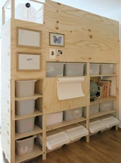 Ikea Ivar transformed into wall divider with plywood covering part of the exterior in an ingenious way.