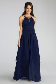 The crystal and pearl neckline perfectly accent this glamorous chiffon gown.