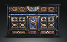 GILTBRONZE-MOUNTED EBONY AND PIETRE DURE CABINET, ROME, SECOND QUARTER 17TH CENTURY Height 21 1/2 in; width 34 2/3 in; depth 13 1/4 in