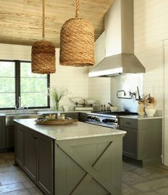 Custom basket chandeliers create an inviting kitchen space.