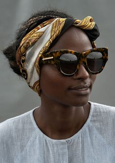 76477fc0635f Accessorized like a pro in cat eye sunglasses and a chic head scarf. www.