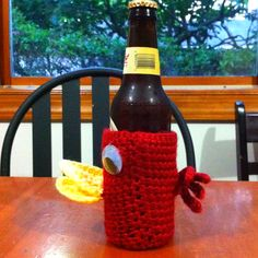 Crocheted bird bottle coozy made for a charity auction.