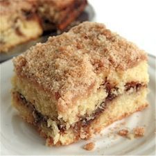 Cinnamon-Streusel Coffeecake - This golden cake is tender and moist, with a middle layer of dark cinnamon filling and a crumbly streusel topping.