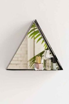 Urban Outfitter's Fitz Triangle Mirror is equally convenient and unique.