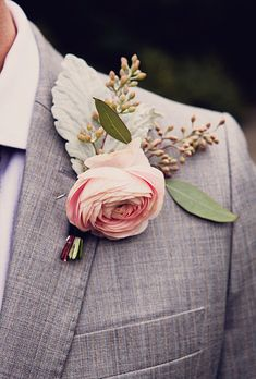 Brides: A Classic Garden Rose Boutonniere. A pink garden rose boutonniere with dusty miller and greenery, created by Jonica Moore Studio.