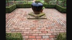 Photo 5:  An older design garden with brick paving creating a lovely space to show case a beautiful garden and urn feature